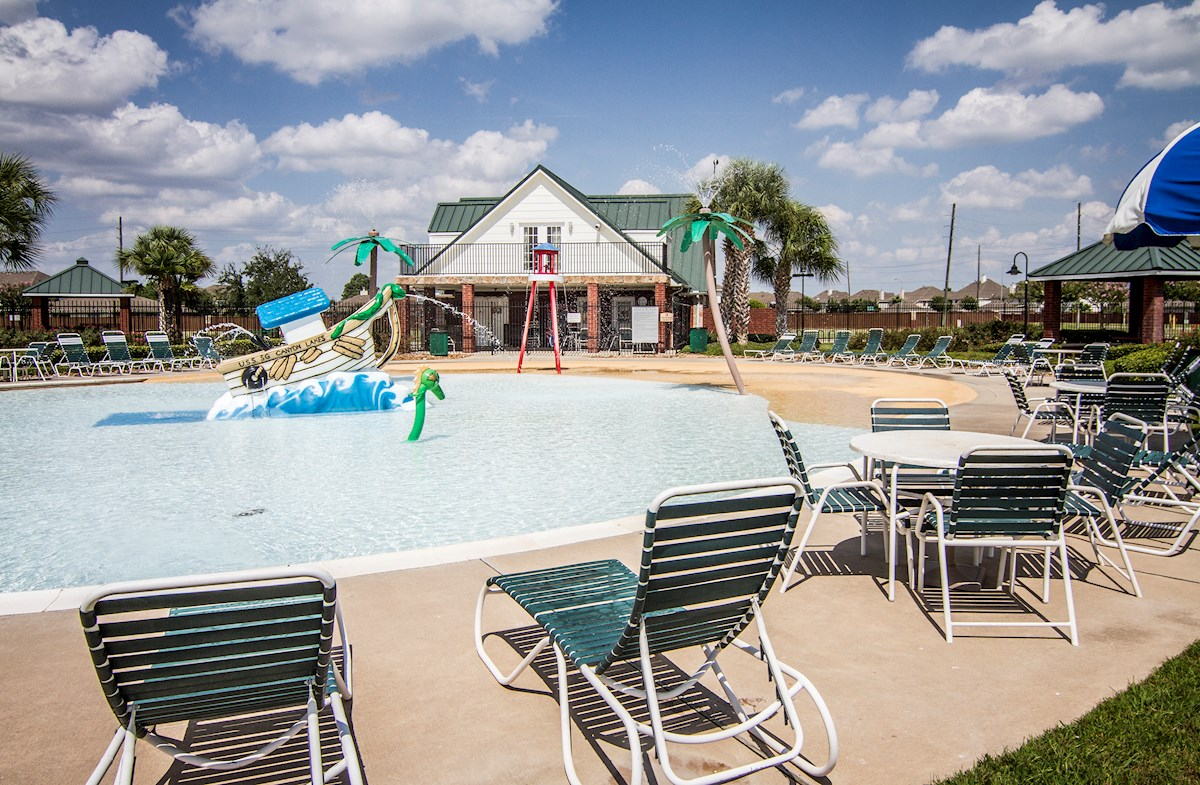 Relaxing community pool with splashpad