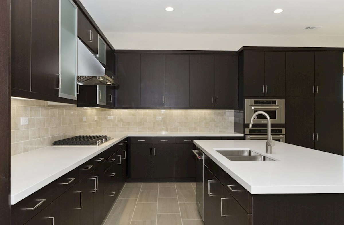 Residence 1 quick move-in Granite countertops and center island with sink provide the ideal location for food preparation