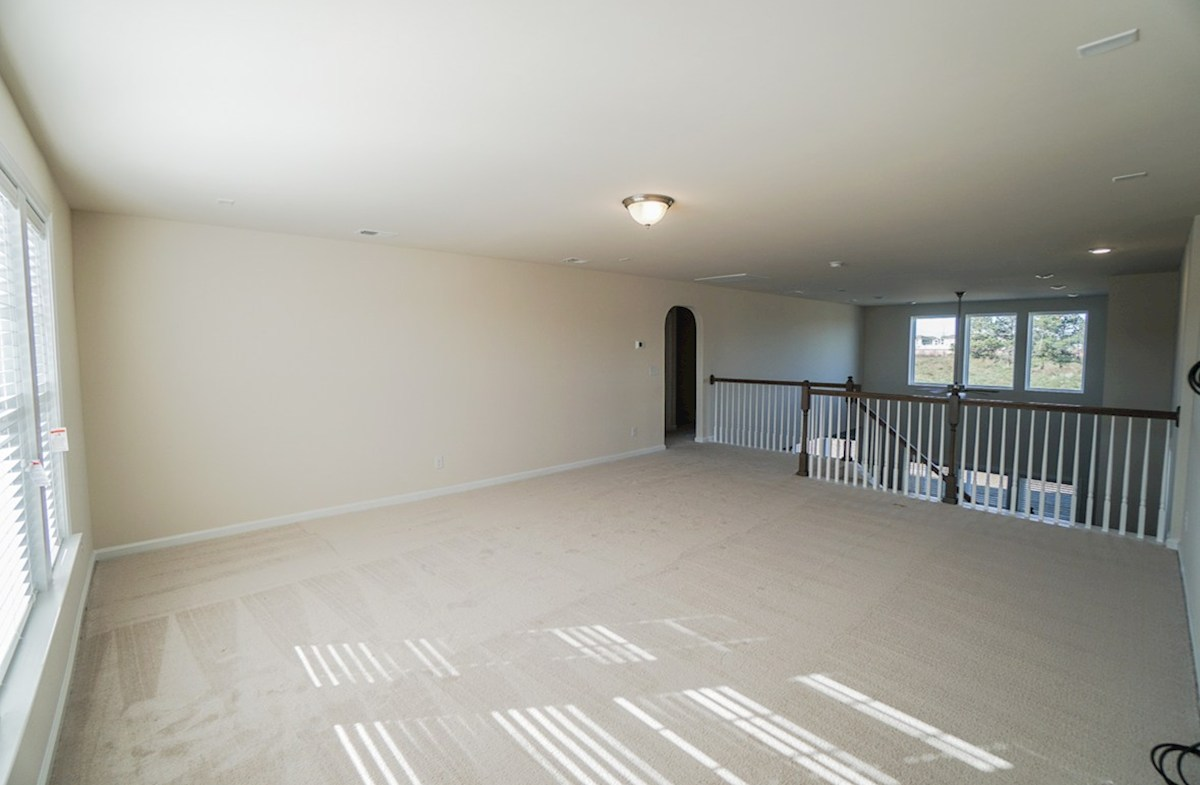 Ivey quick move-in loft is open to the great room with plenty of space