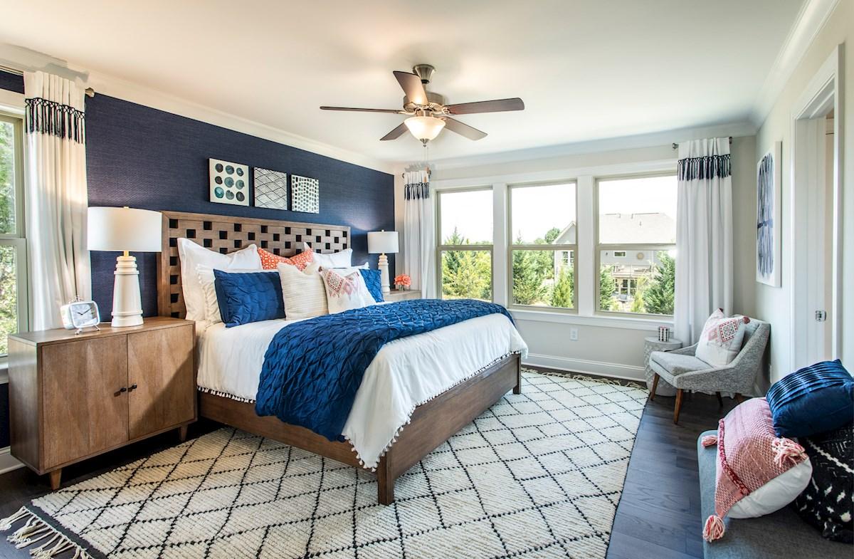 Master bedroom with dark hardwood floors