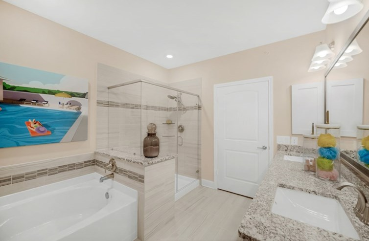 Sherwood primary bathroom with separate garden tub and shower