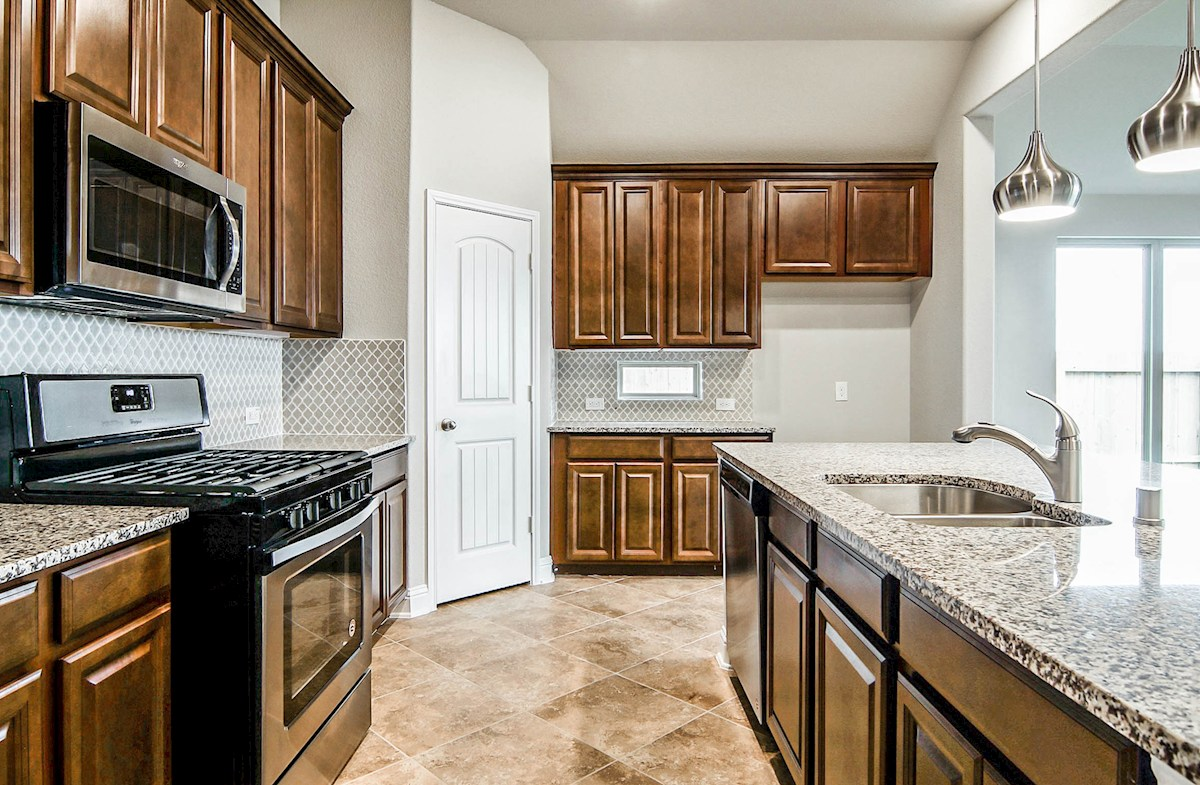 Madison quick move-in kitchen with granite counters and spacious cabinets
