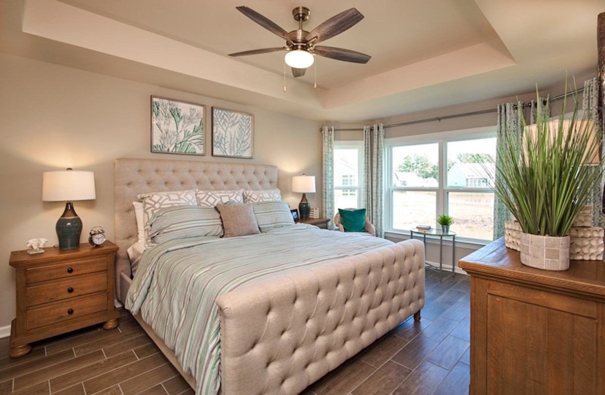Bella Vita Camden master bedroom features bay windows