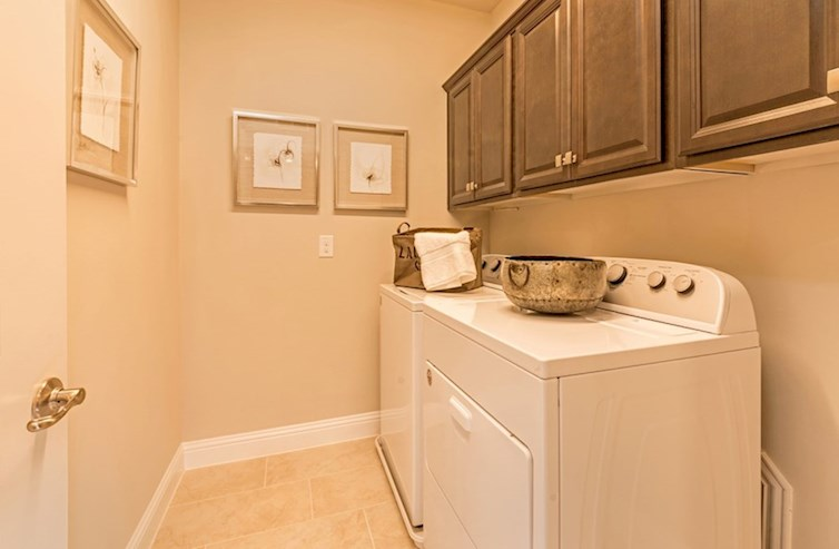 Dorset laundry room with built-in cabinets