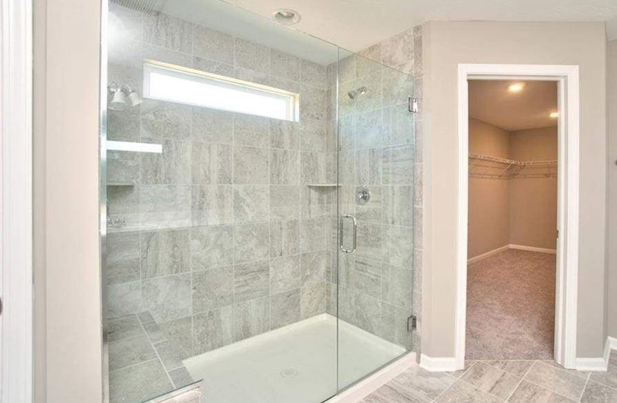 Whitley quick move-in Spa shower with bench and dual shower heads