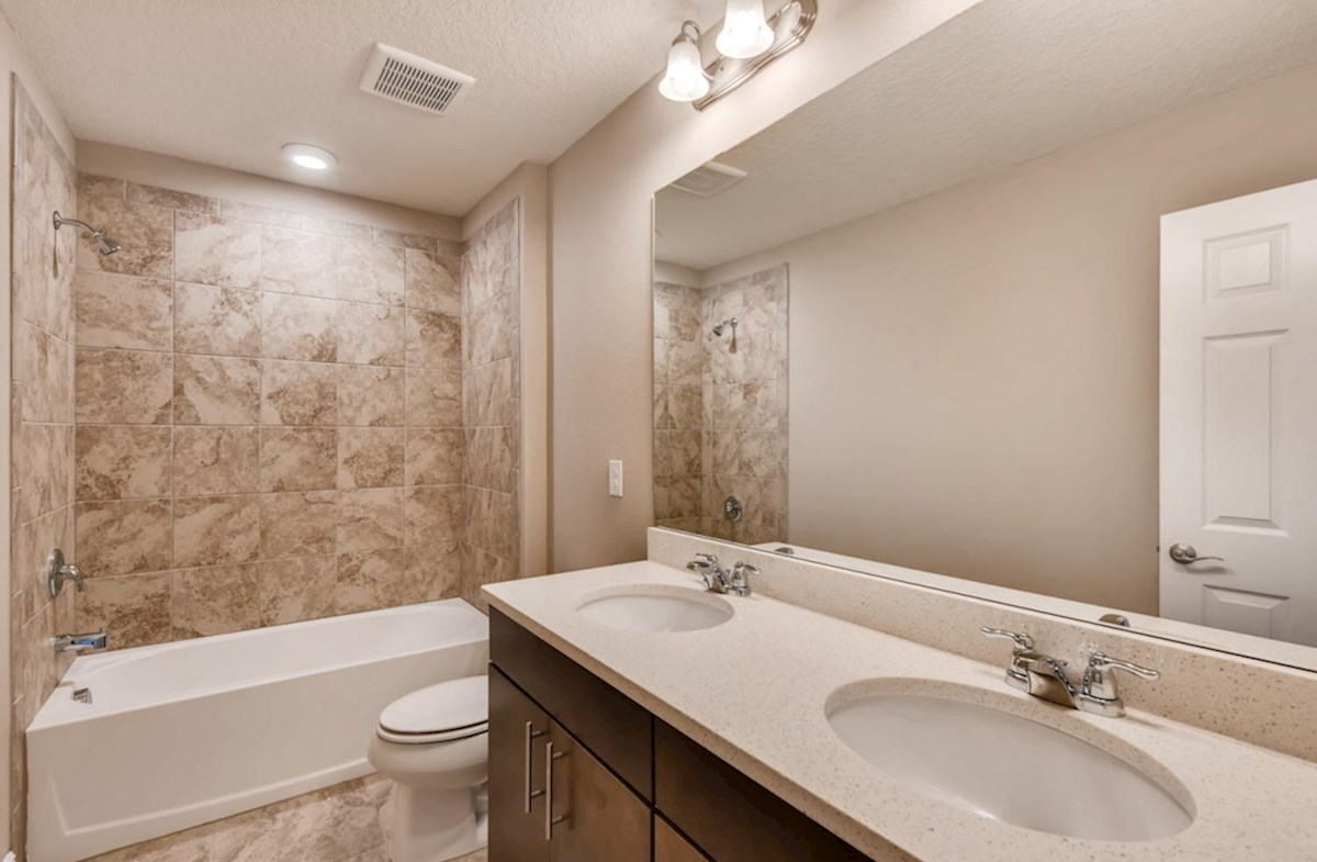 Lucia Bay quick move-in Secondary bathroom with dual sink vanity