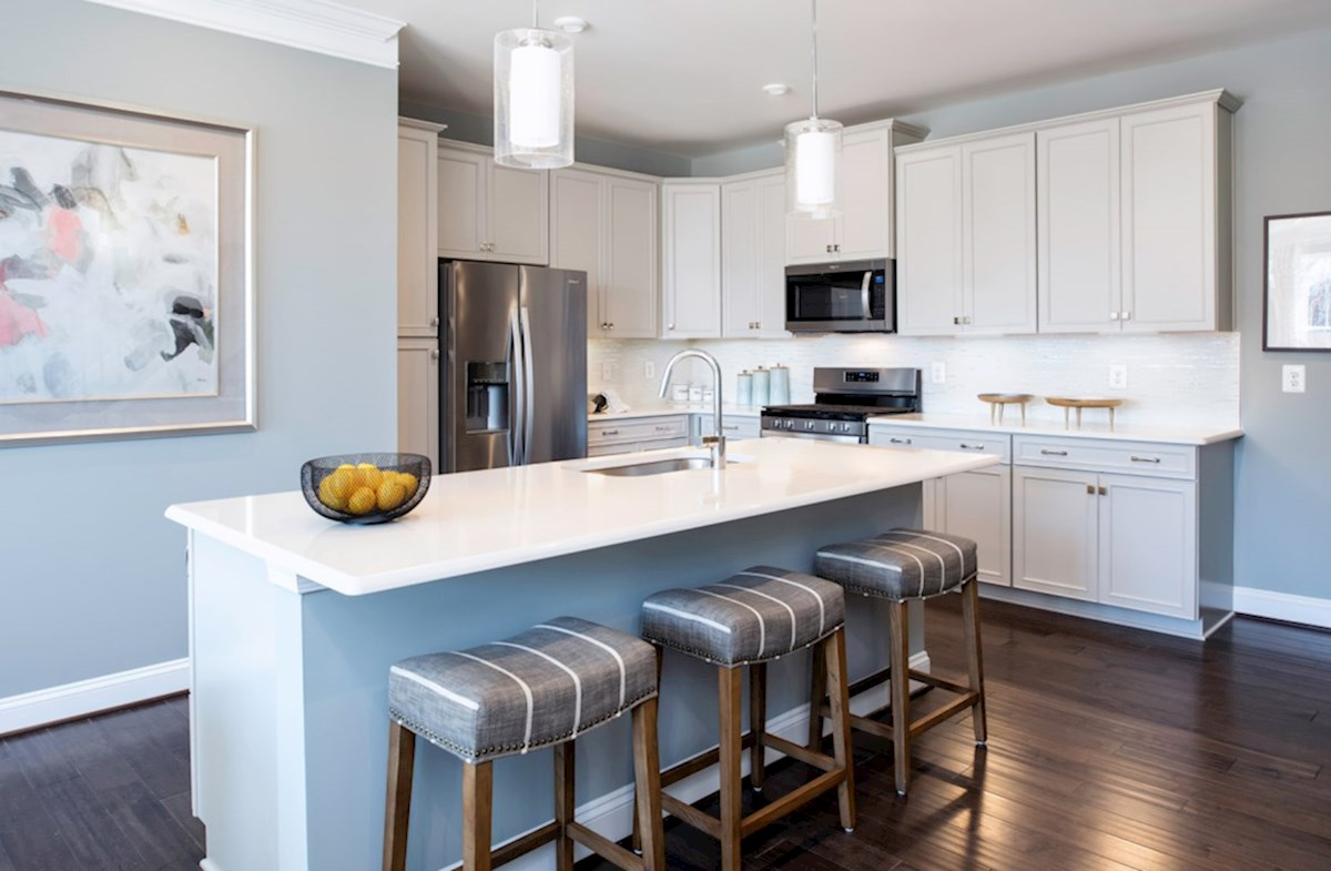 Riverwalk at Crofton Condos Riva Riva kitchen featuring granite and stainless steel
