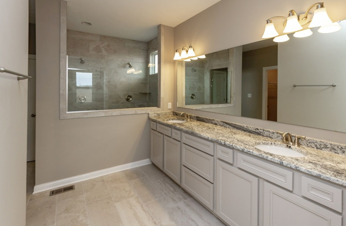 Capitol quick move-in master bathroom with dual sinks