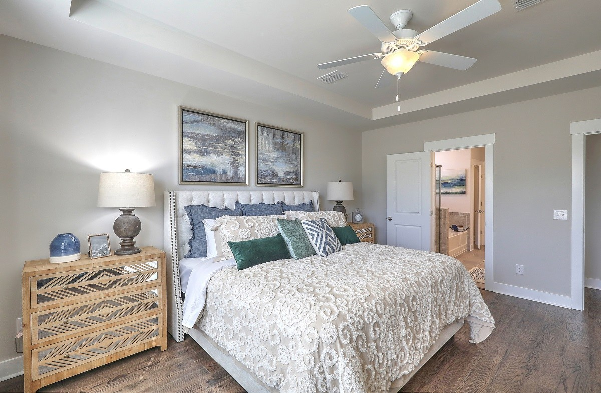 Jasmine Point at Lakes of Cane Bay Sweetgum cozy master bedroom