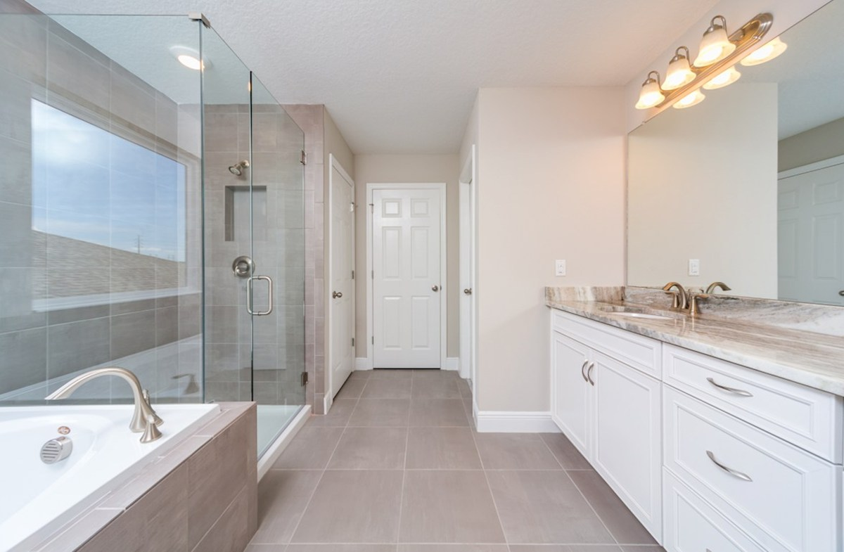 Sand Dollar quick move-in Master bath with garden tub, dual vanity and glass shower