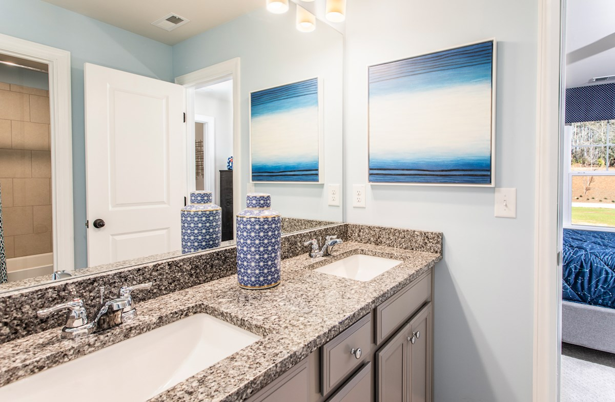 Secondary Bathroom with granite countertops