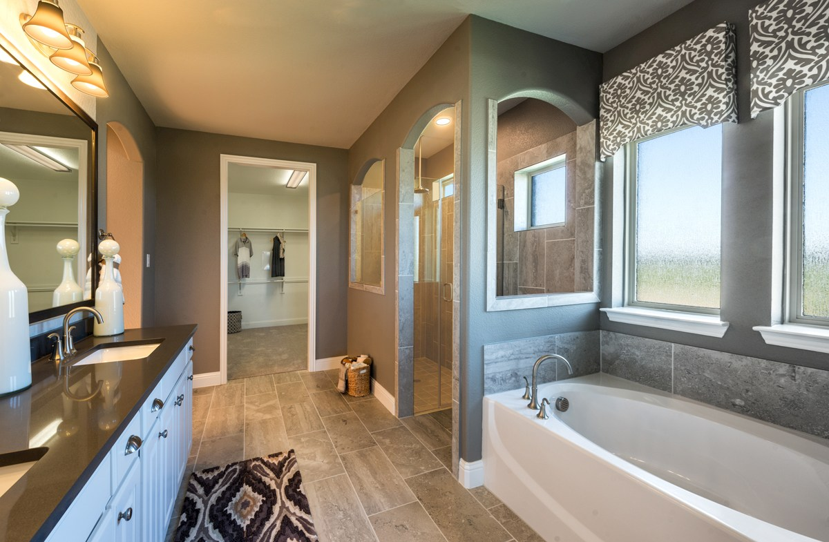 Glen View Trinity Trinity master bathroom with large shower and garden tub