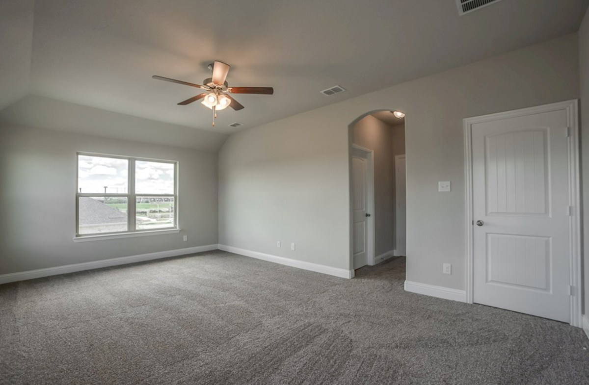 Fairfield quick move-in master bedroom with carpet and ceiling fan