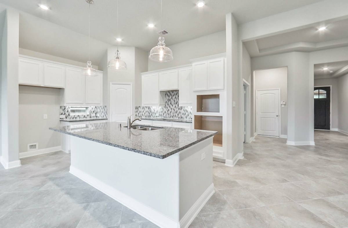Madison quick move-in kitchen with large granite island