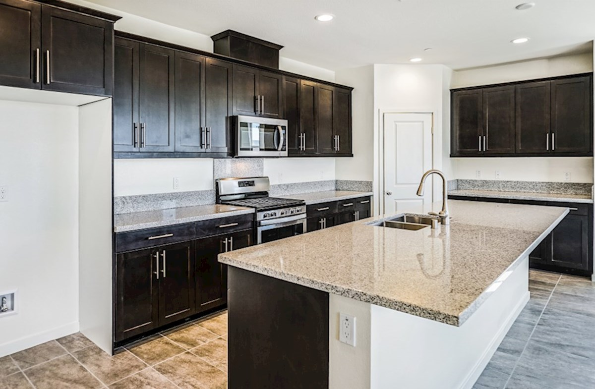 Poppy quick move-in Gourmet kitchen boasts an oversized island, stainless steel appliances, and stunning granite countertops
