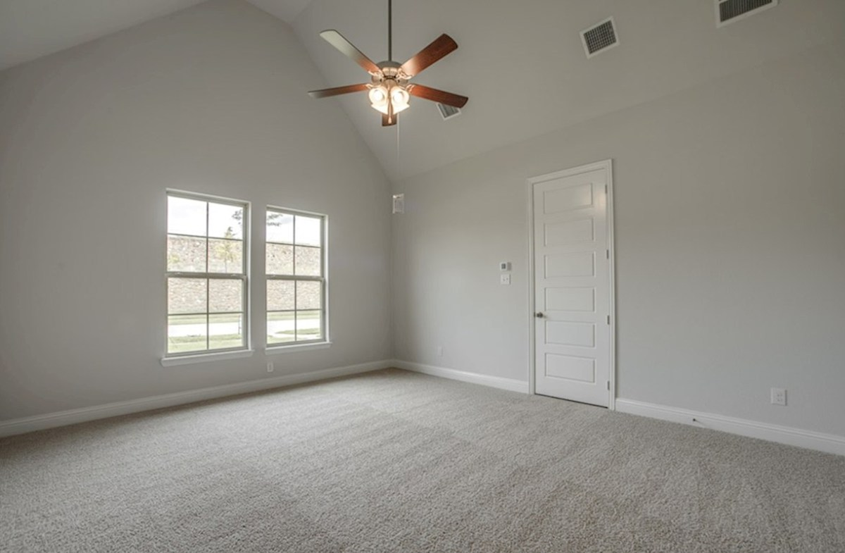 Brighton quick move-in master bedroom with large windows, carpet and ceiling fan