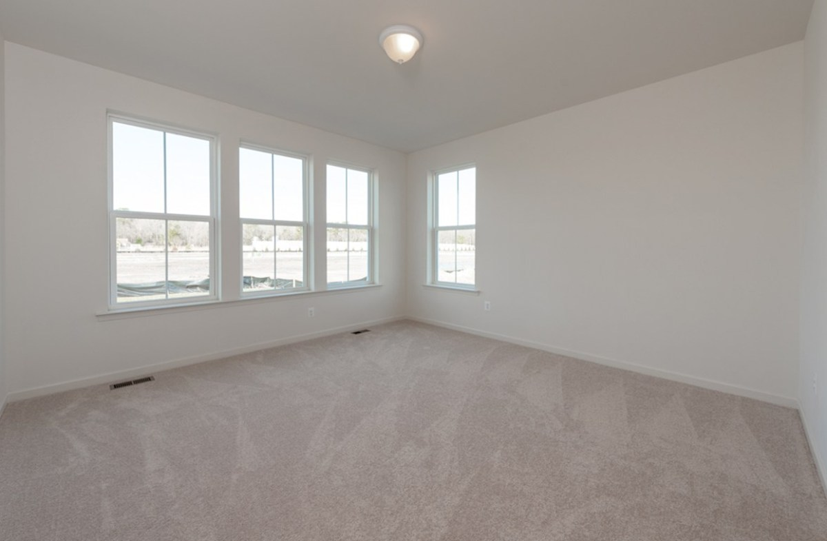 Darley quick move-in Darley master suite with carpet and large windows