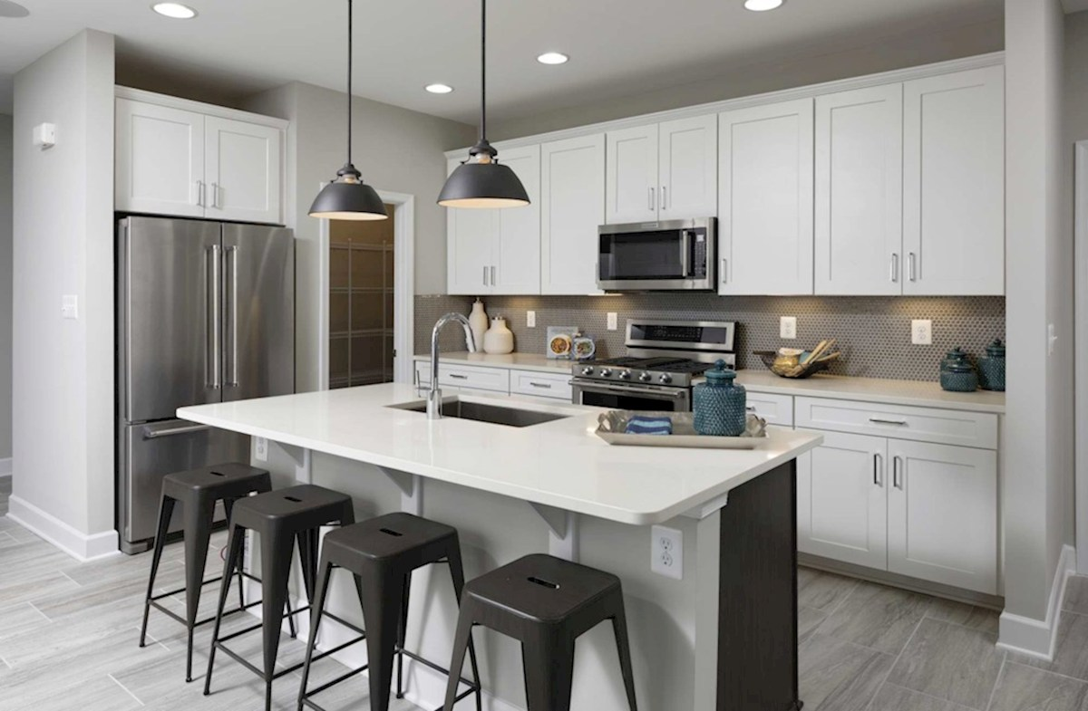Heron's Ridge at Bayside Bethany Bethany Kitchen featuring stainless steal appliances