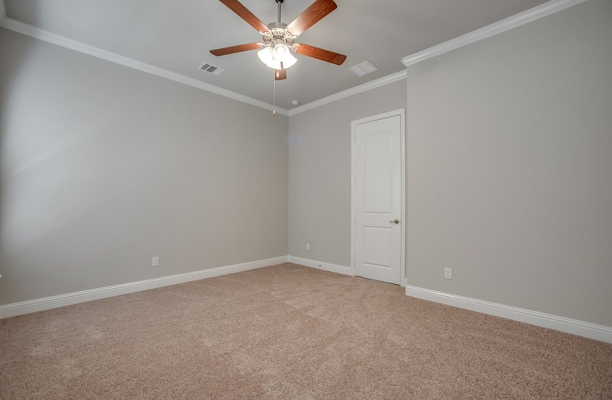 Eastland quick move-in master bedroom with carpet and ceiling fan