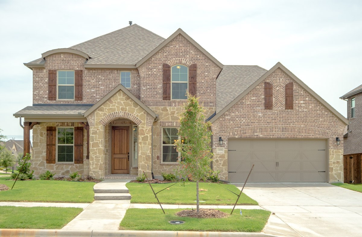 Gruene FCL quick move-in Gruene offering brick and stone exterior