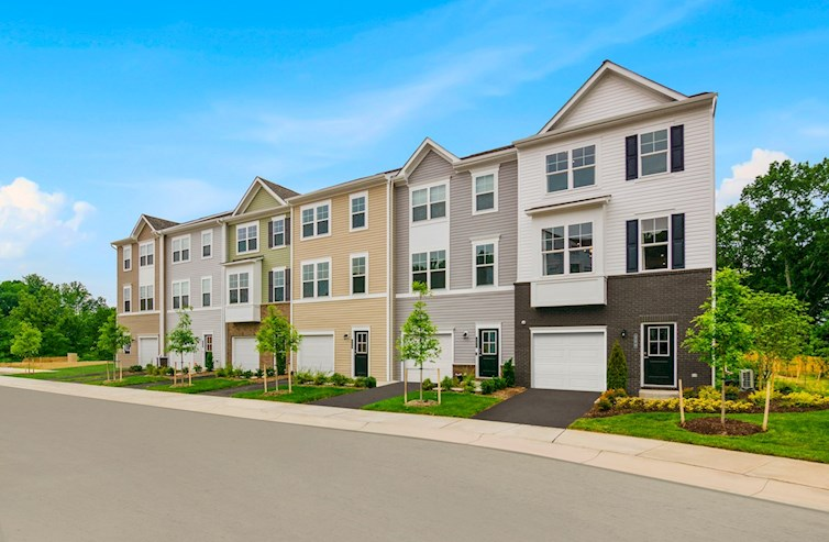 day exterior of a row of six Cameron townhomes