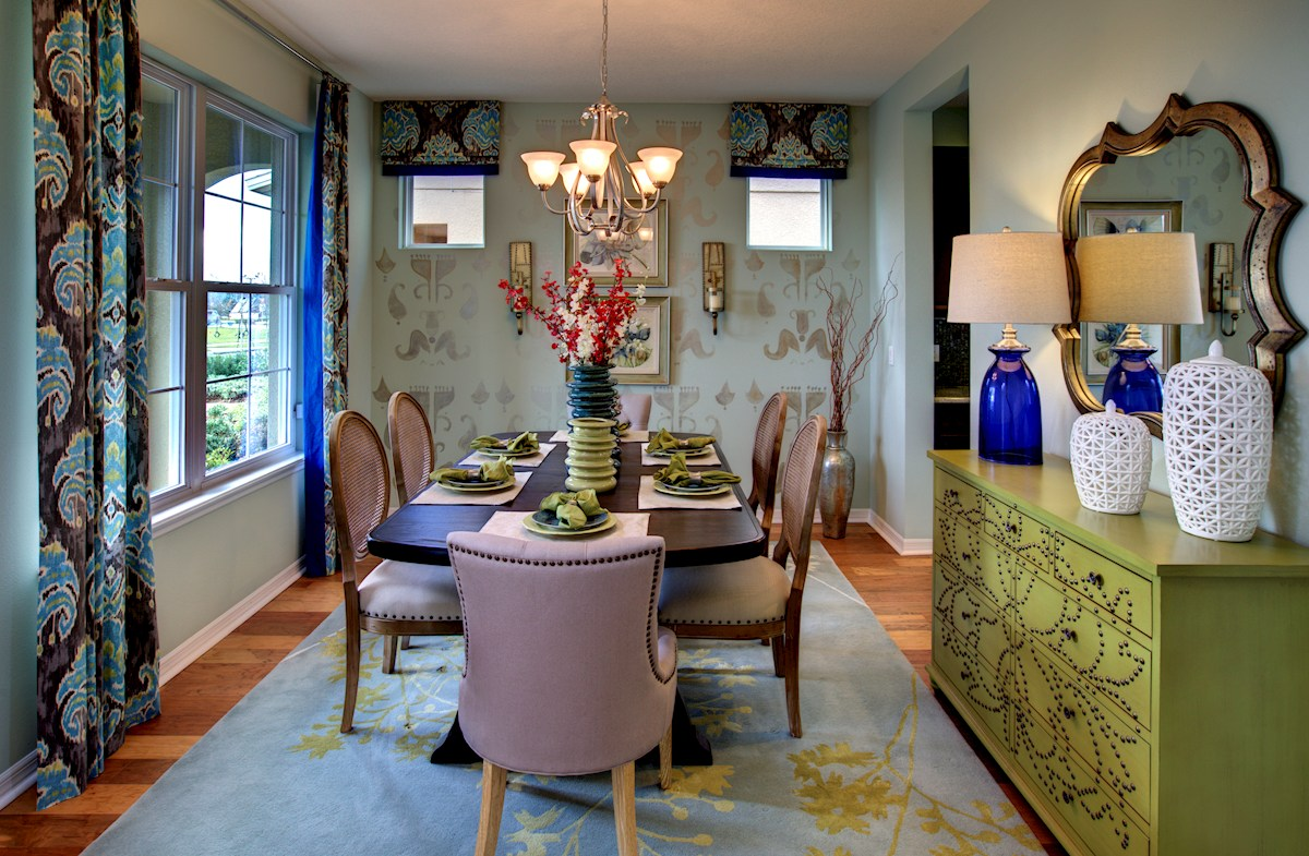 The Reserve at Pradera Anna Maria Furnished formal dining room with large window