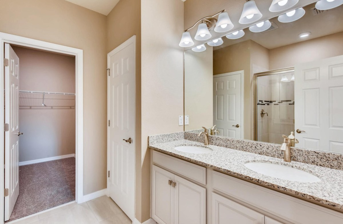 Kemerton Place Key Biscayne master bath features dual vanity and glass enclosed walk-in shower