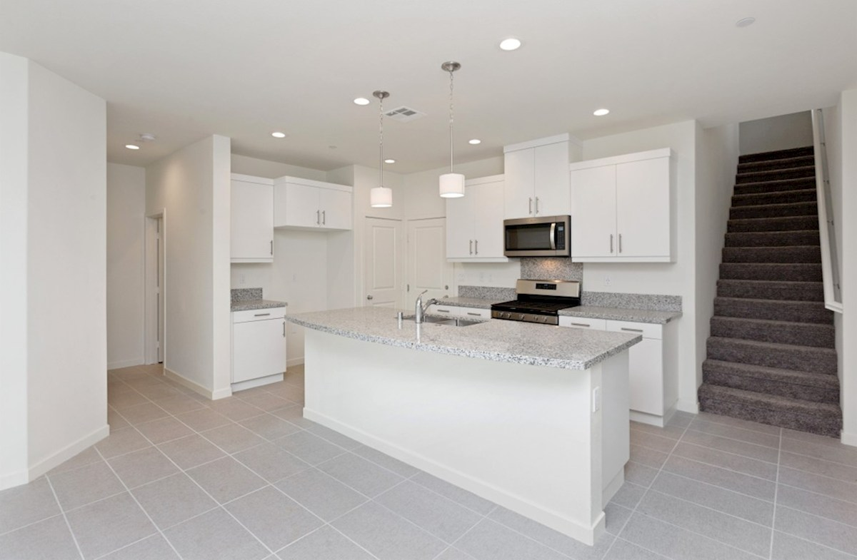 Snowberry quick move-in Granite countertops and center island with sink provide the ideal location for food preparation
