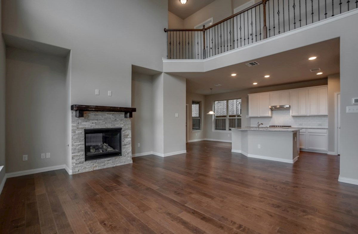 Fairfield quick move-in great room with stone fireplace with wood floors
