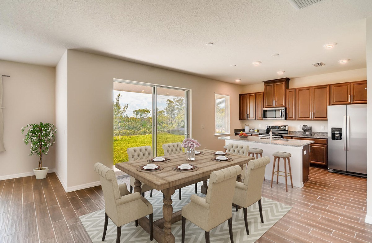 The Reserve at Pradera Sanibel Open dining and kitchen with wood-look tile
