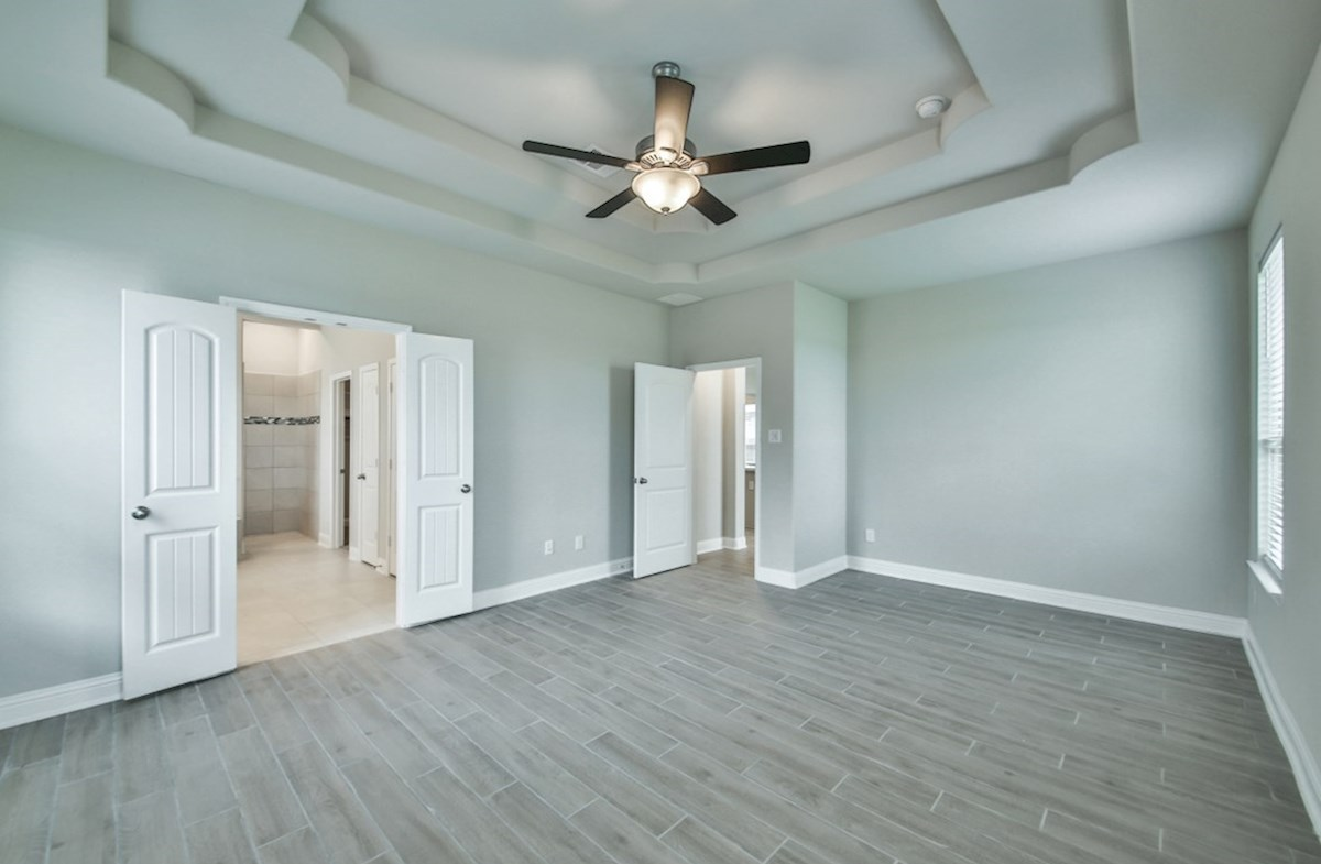 Bandera quick move-in master bedroom with tile flooring