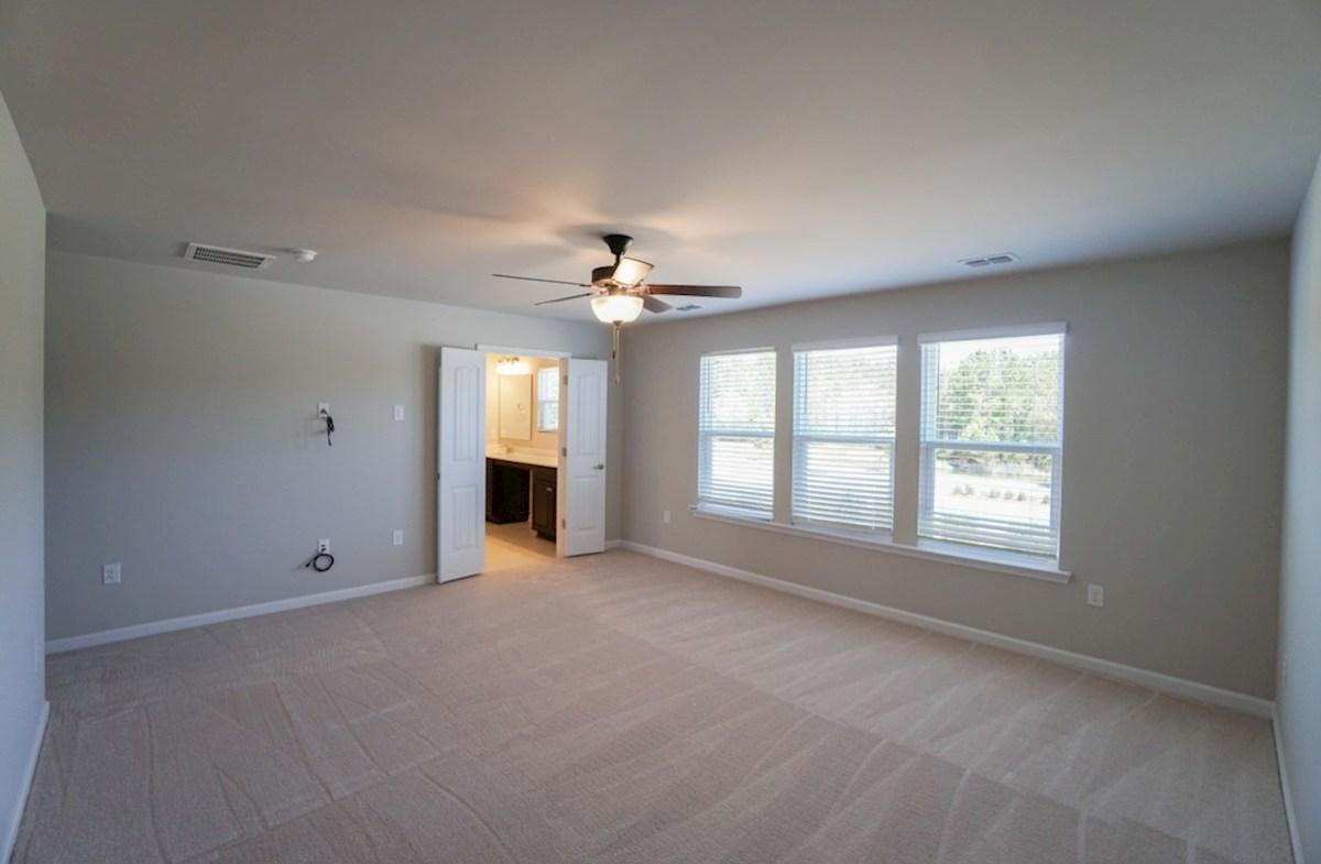 Edisto quick move-in master bedroom features multiple windows