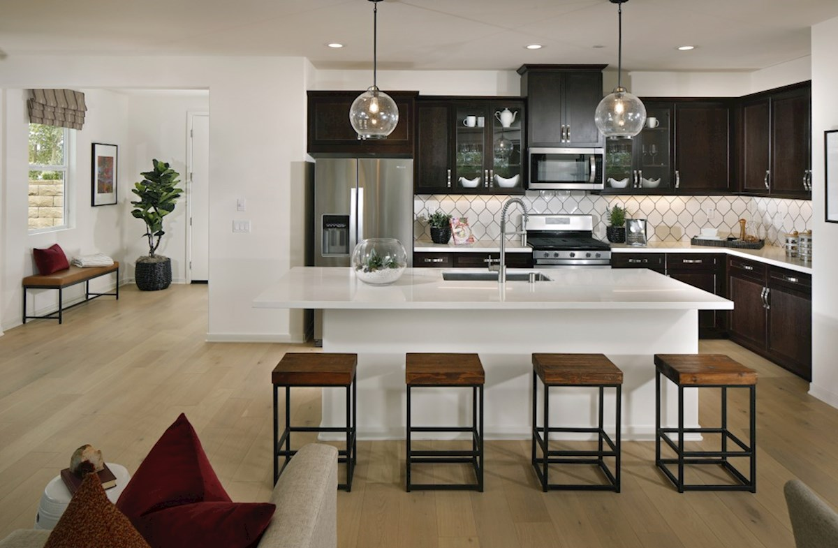 Barcelona Quartz Granite countertops and center island with sink provide the ideal location for food preparation