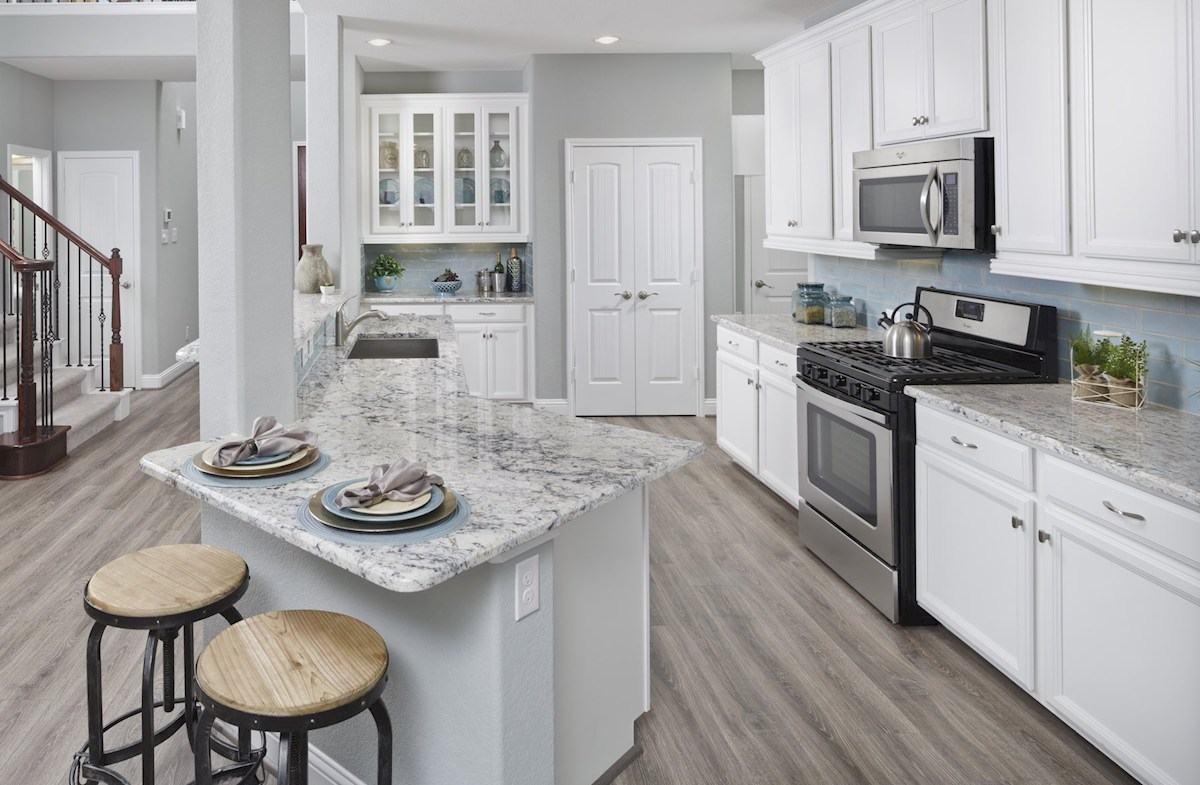 kitchen with granite counters and white cabinets