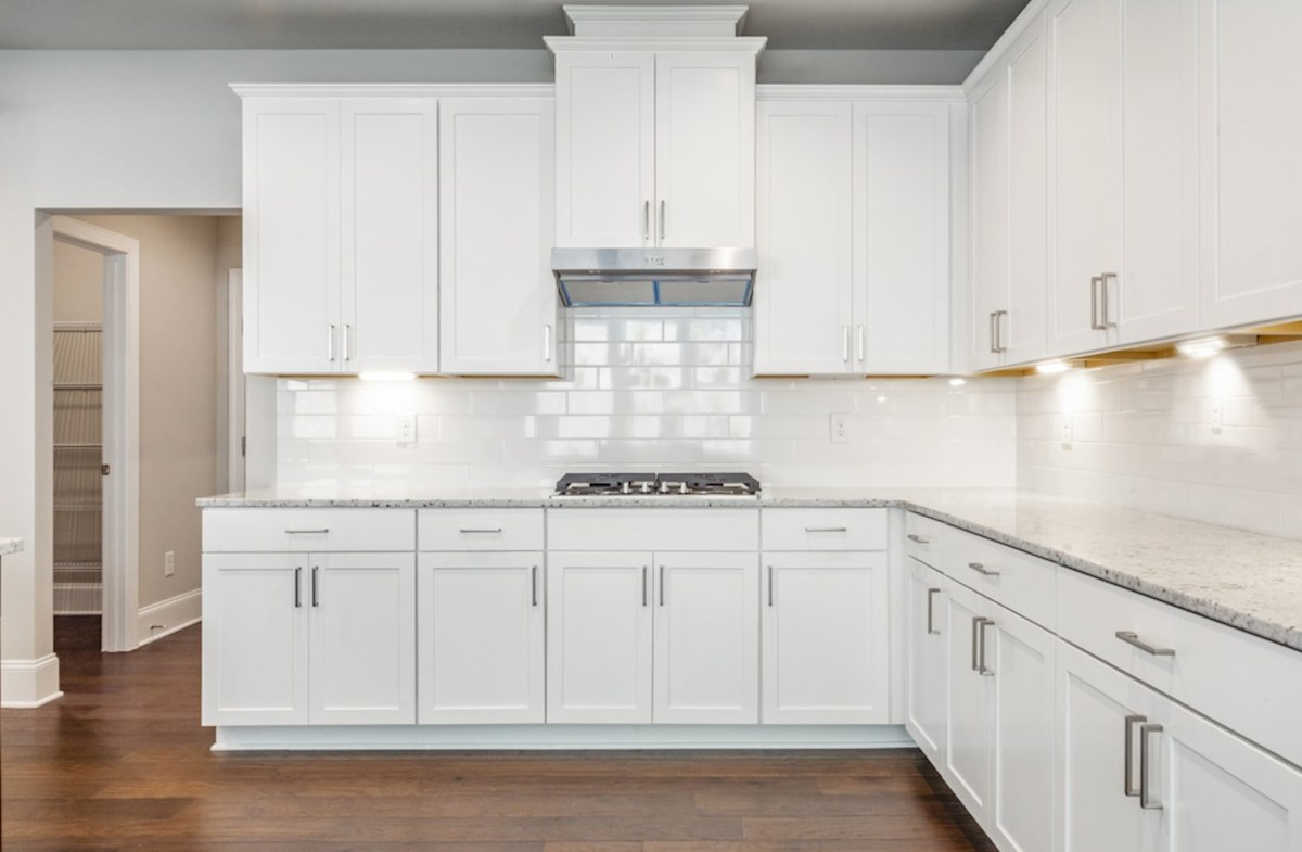 Fairfield quick move-in Kitchen with white cabinets
