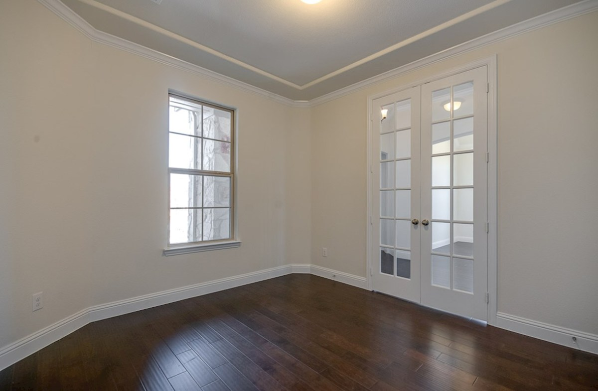 Kerrville quick move-in study with wood floors and French doors