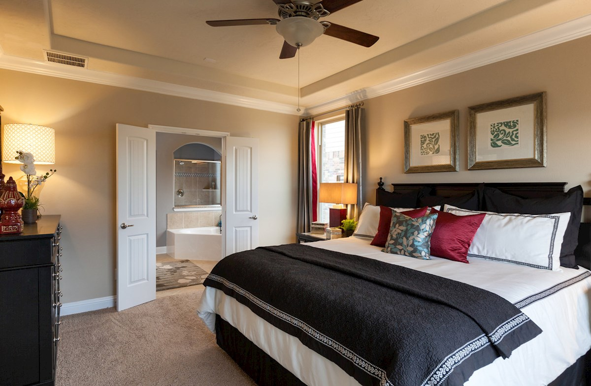 Young Ranch Fenway master bedroom with tray ceiling