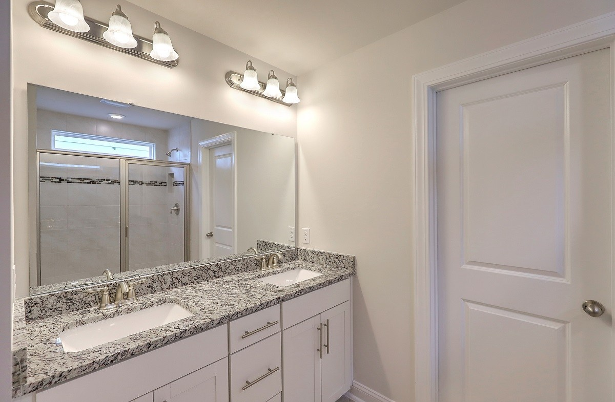 Jasmine Point at Lakes of Cane Bay Maple well-appointed master bathroom