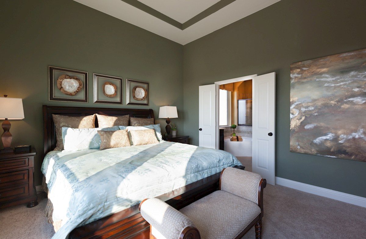 King Crossing Galveston  master bedroom with ceiling fan and carpet