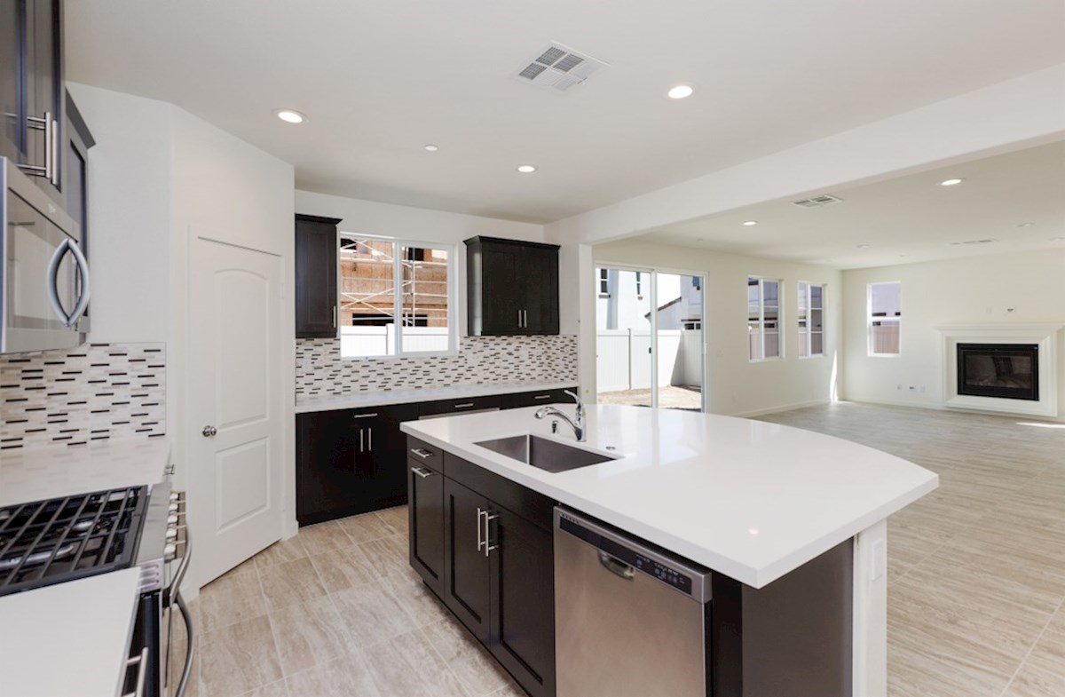 Aster X quick move-in Gourmet kitchen boasts an oversized island, stainless steel appliances, and stunning granite countertops