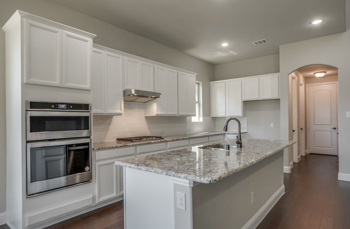 Summerfield quick move-in open kitchen with island and white cabinets