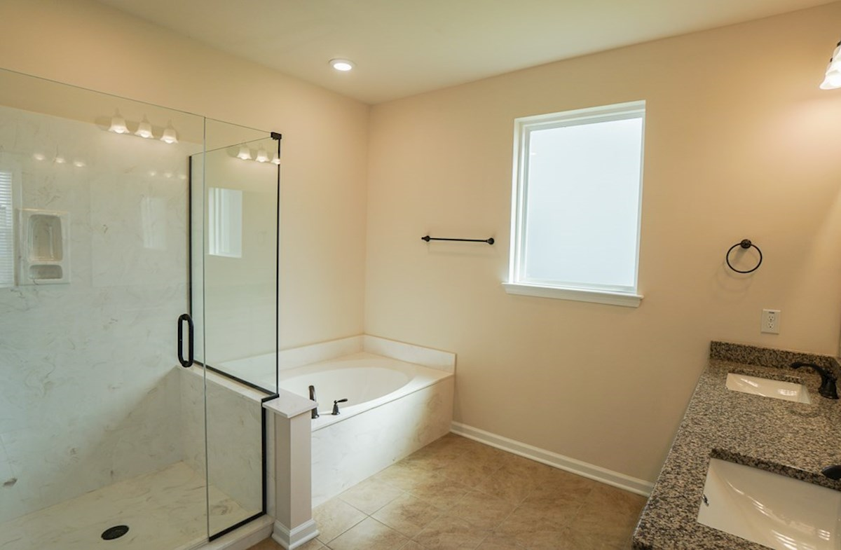 Valleydale quick move-in master bathroom features dual show and tub