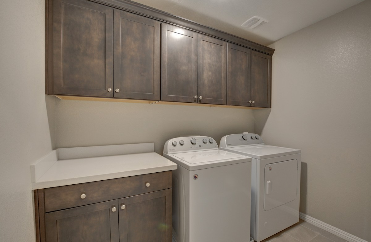 Enjoy extra storage in the Celeste laundry room