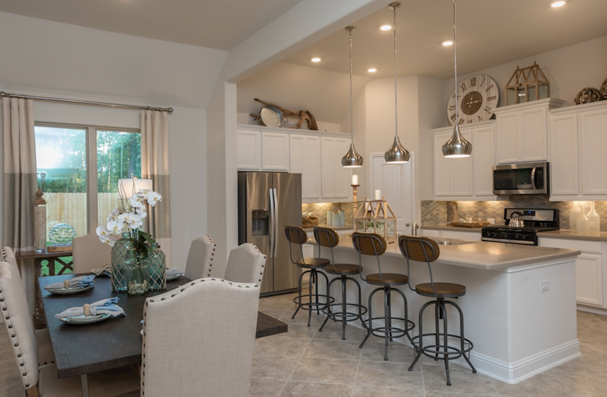 kitchen with granite counterts and pendant lights