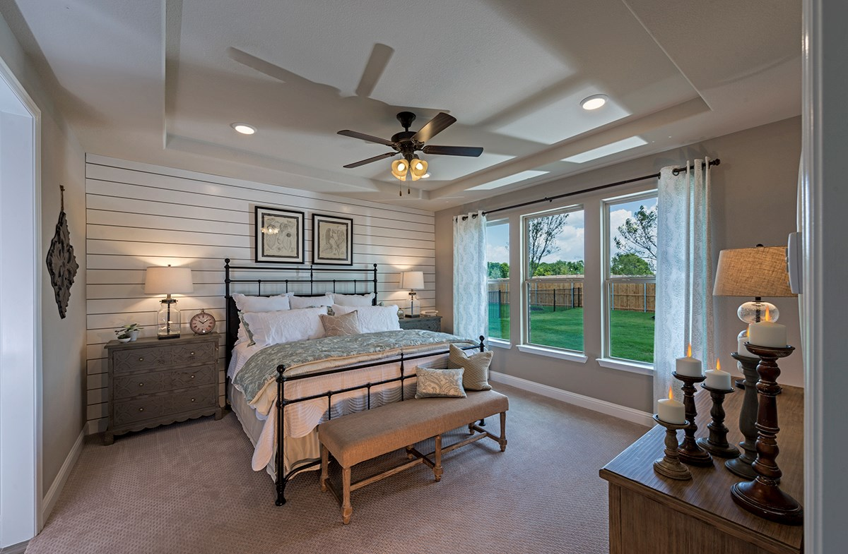 master bedroom with tiered ceiling