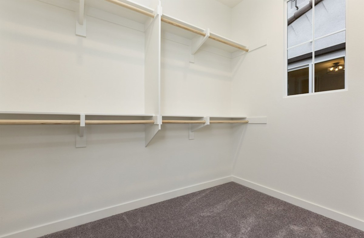 Mission Lane Pinyon Walk-in closet is designed for easy movement between shelves and optimal hanging and storage space