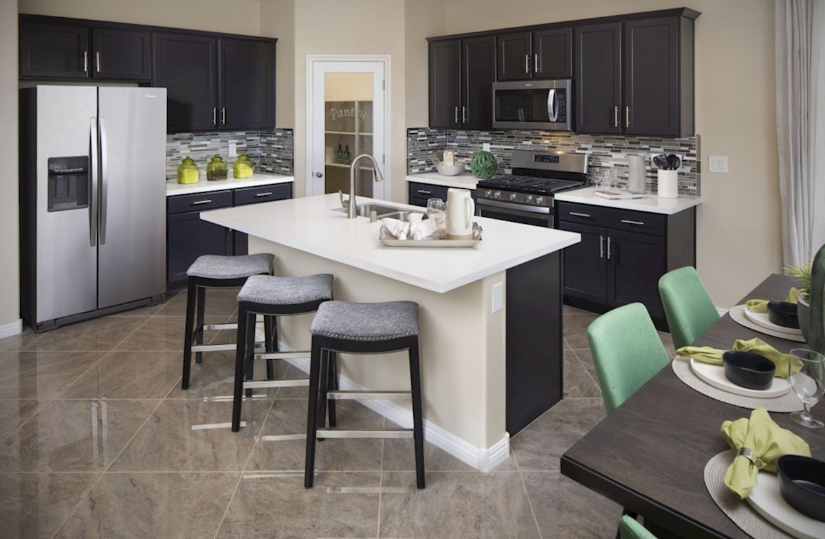 Hamilton Place Mesquite kitchen features granite countertops