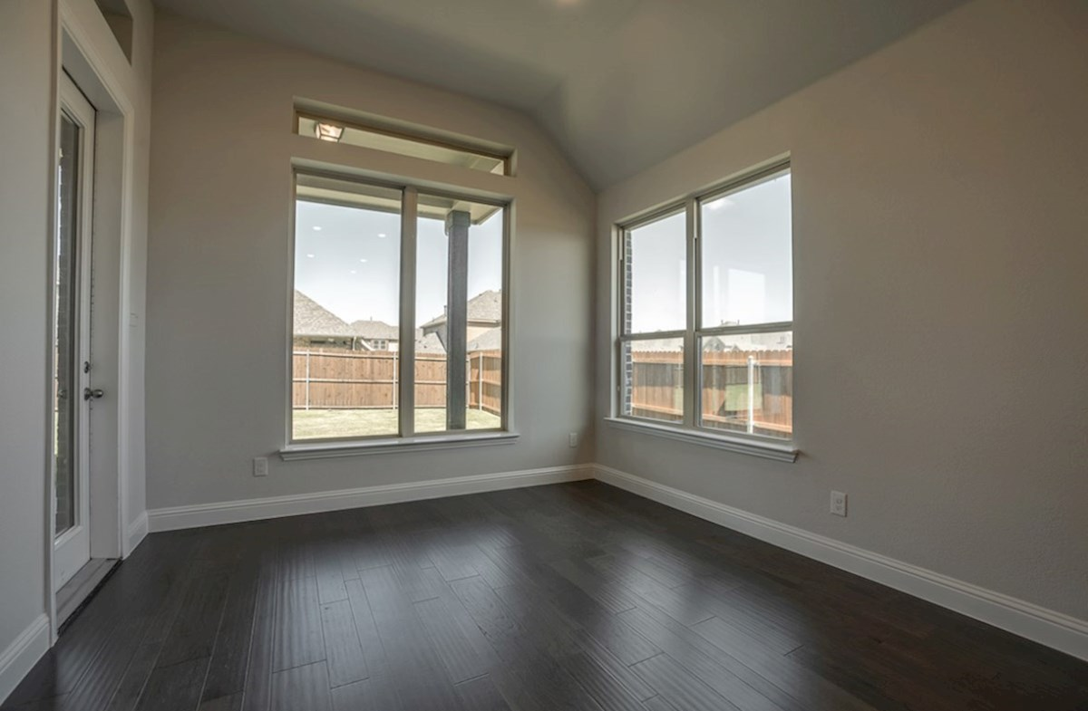 Kerrville quick move-in breakfast nook with wood floors and large windows