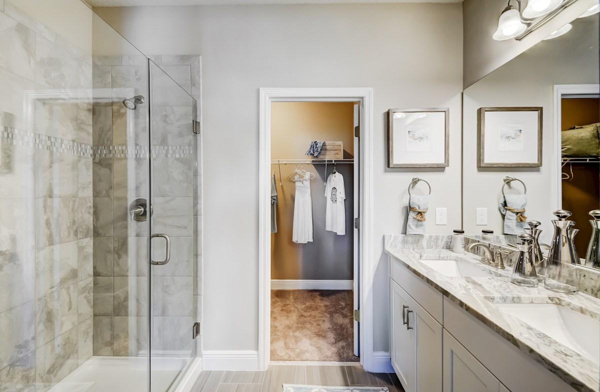 Aqua Solis Aruba - Exterior master bathroom with dual sinks and glass shower