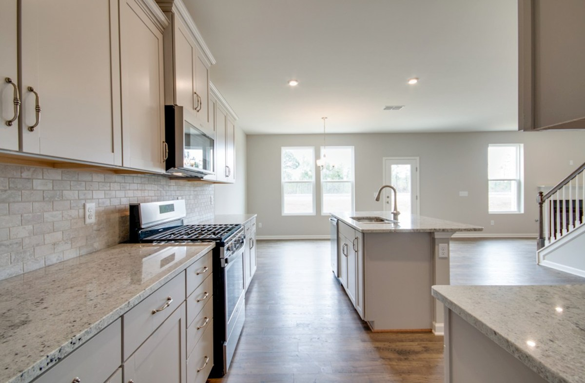 Ashford quick move-in kitchen with backsplash and center island